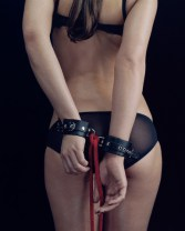 Burlesque Performer Wearing Handcuffs